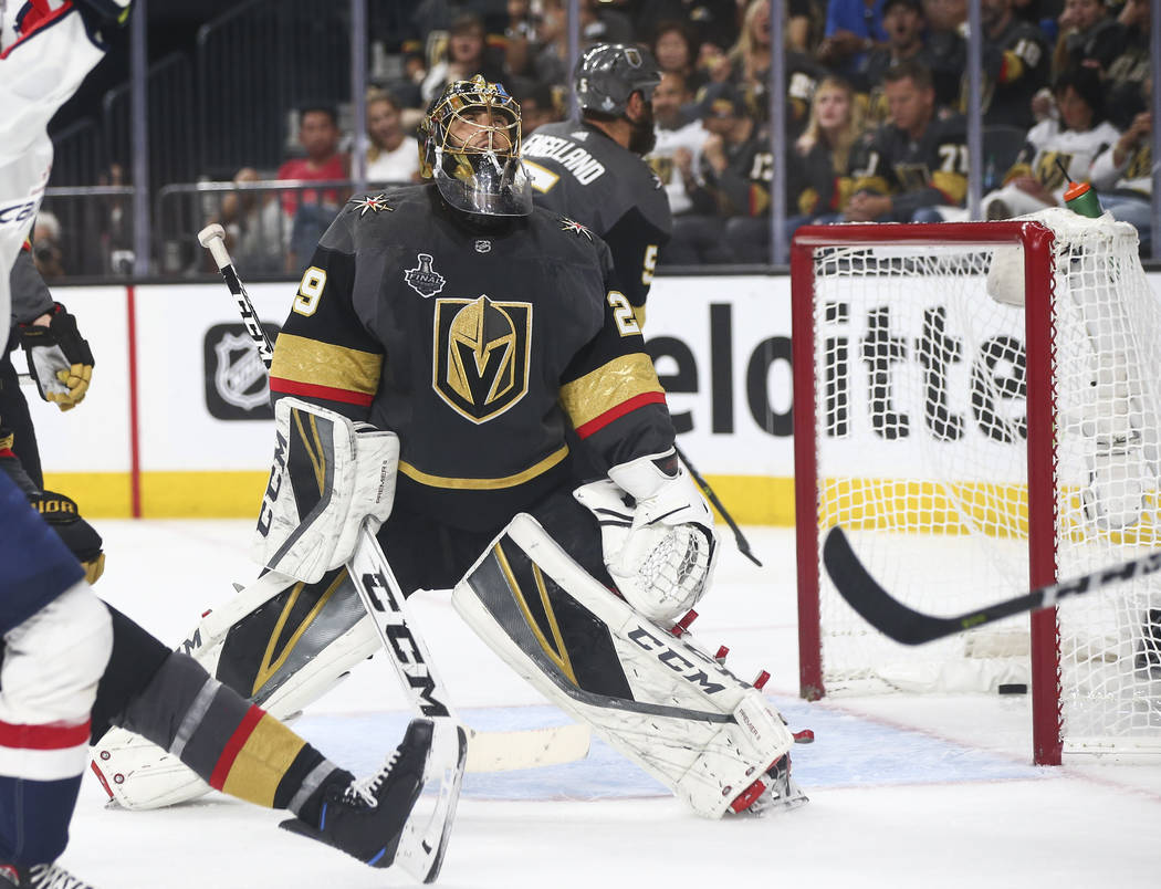 Golden Knights goaltender Marc-Andre Fleury (29) gets scored on by the Washington Capitals after the puck bounced off the crossbar during the second period of Game 2 of the NHL hockey Stanley Cup ...