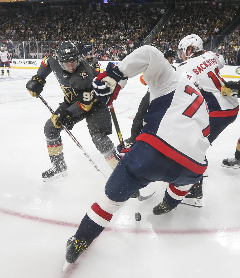Golden Knights left wing Tomas Nosek (92) battles for the puck against Washington Capitals right wing T.J. Oshie (77) during the second period of Game 2 of the NHL hockey Stanley Cup Final at the ...