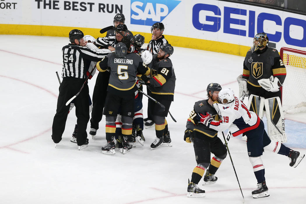 Vegas Golden Knights and Washington Capitals players get into a scuffle during the first period in Game 2 of the NHL hockey Stanley Cup Final at T-Mobile Arena in Las Vegas, Wednesday, May 30, 201 ...