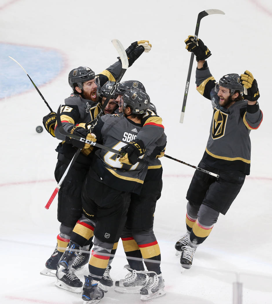 Vegas Golden Knights right wing Reilly Smith (19) celebrates a score with his team against Washington Capitals during the first period in Game 2 of the NHL hockey Stanley Cup Final at T-Mobile Are ...