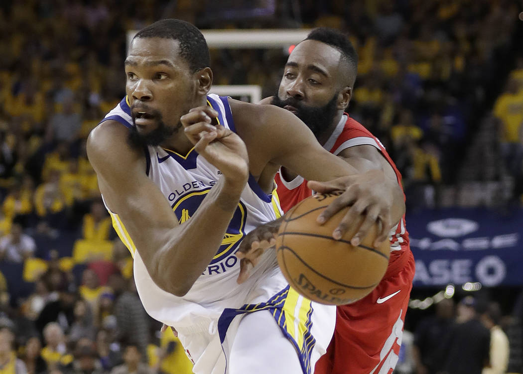 Golden State Warriors forward Kevin Durant, left, drives against Houston Rockets guard James Harden during the second half of Game 6 of the NBA basketball Western Conference Finals in Oakland, Cal ...