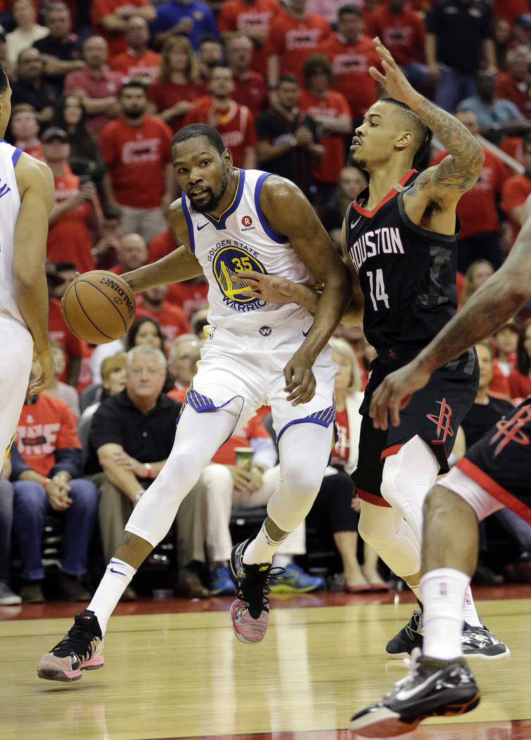 Golden State Warriors forward Kevin Durant (35) drives around Houston Rockets guard Gerald Green (14) during the first half in Game 7 of the NBA basketball Western Conference finals, Monday, May 2 ...