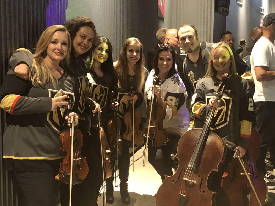 The Vegas Golden Strings, from left, DeAnn Letourneau, Melanie Schiemer, Liz Bedrosian, Krista Solars, Rachael Brown, Mert Sermet,Tianna Harjo and Dalton Davis, are shown prior to Game 2 of the St ...
