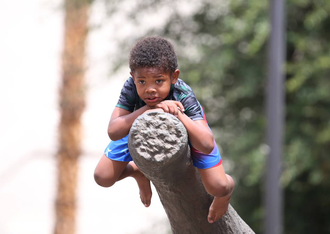 Sir Mosley, 6, takes a break after playing at Sunset Park on Thursday, May 31, 2018, in Las Vegas. Bizuayehu Tesfaye/Las Vegas Review-Journal @bizutesfaye