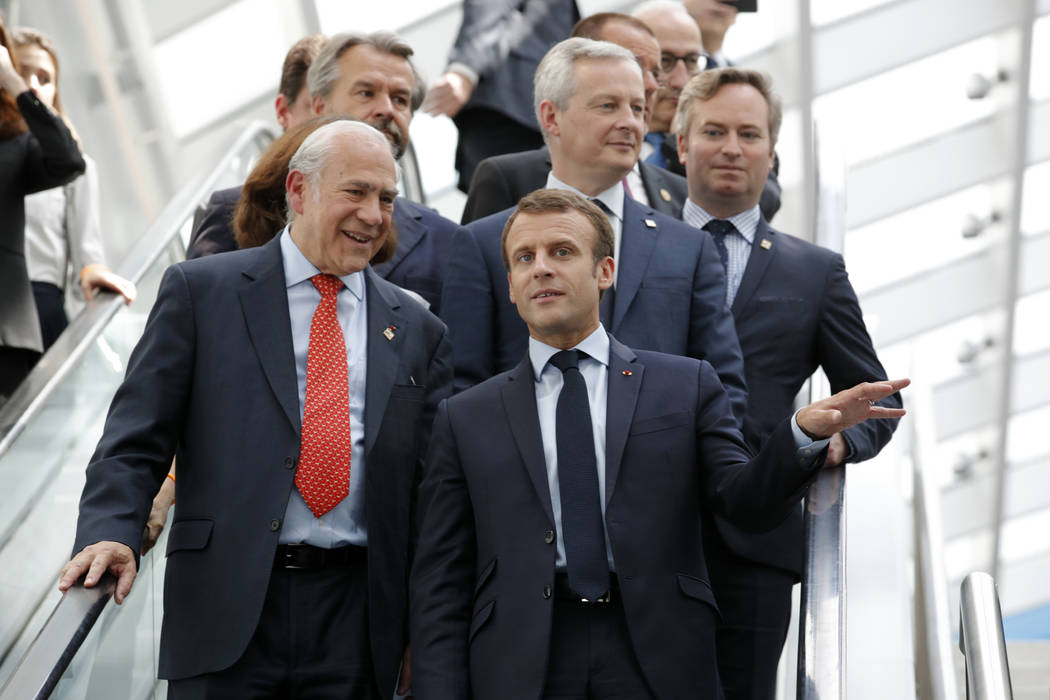 """French President Emmanuel Macron, right, and Organisation for Economic Co-operation and Development Secretary-General Angel Gurria arrive at the OECD ministerial council meeting on """"Refounding Mul ..."""