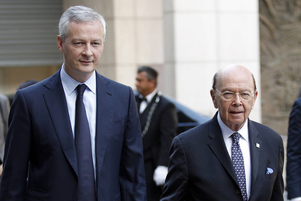 French Finance Minister Bruno Le Maire, left, welcomes US Secretary of Commerce Wilbur Ross prior to their meeting at French Economy Ministry in Paris, Thursday, May 31, 2018. U.S. tariffs on Euro ...