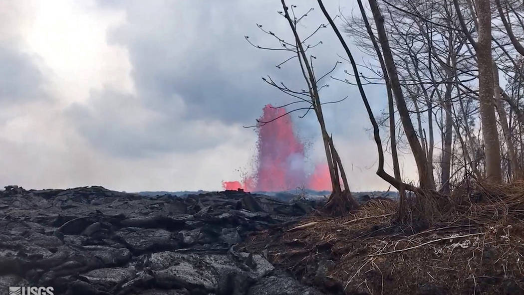 This May 29, 2018 photo from video provided by the U.S. Geological Survey shows lava from a fissure created fountains to heights of 200 feet at times, near Pahoa, Hawaii. (U.S. Geological Survey v ...
