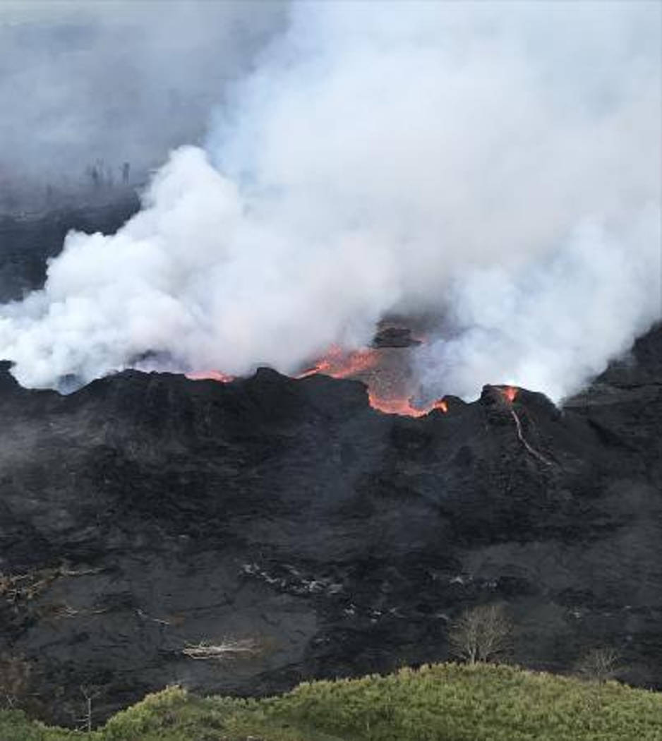 In this Saturday, May 26, 2018, image released by the U.S. Geological Survey HVO shows an aerial view of fissure 22 looking toward the south, as Kilauea Volcano continues its eruption cycle near P ...