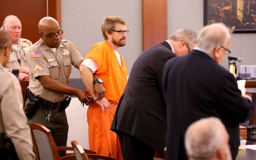 Jeremy Strohmeyer, who sexually assaulted and killed 7-year-old Sherrice Iverson in a Primm casino restroom 21 years ago, has his right hand freed to take notes during a hearing at the Regional Ju ...