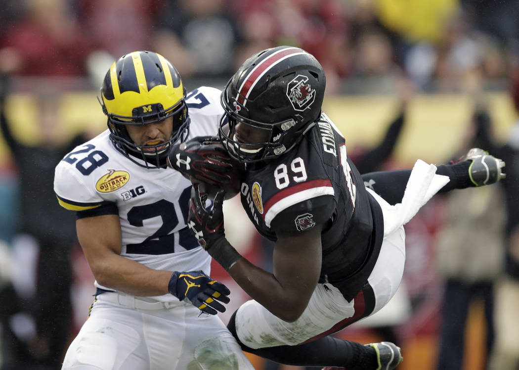 South Carolina wide receiver Bryan Edwards (89) pulls in a 21-yard touchdown reception in front of Michigan defensive back Brandon Watson (28) during the second half of the Outback Bowl NCAA colle ...