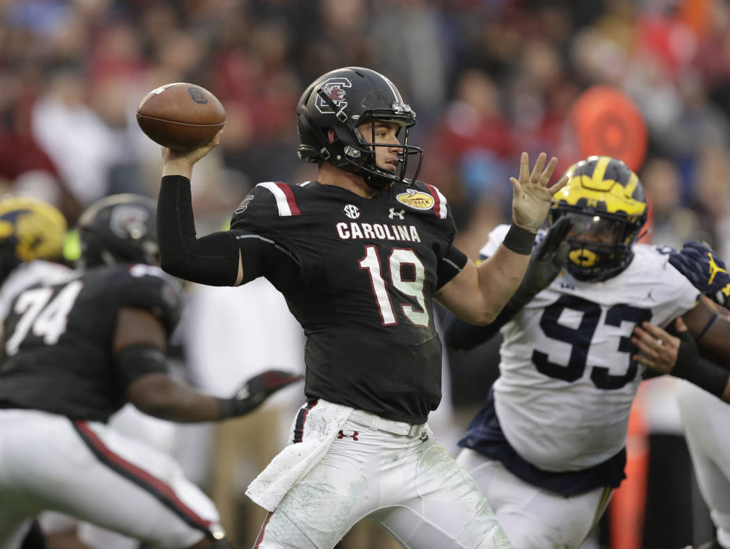 South Carolina quarterback Jake Bentley throws a pass against Michigan during the second half of the Outback Bowl NCAA college football game Monday, Jan. 1, 2018, in Tampa, Fla. South Carolina won ...