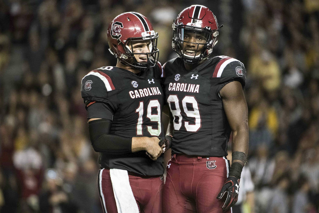 South Carolina quarterback Jake Bentley (19) and Bryan Edwards (89) celebrate after a touchdown during the second half of an NCAA college football game against Wofford on Saturday, Nov. 18, 2017 i ...