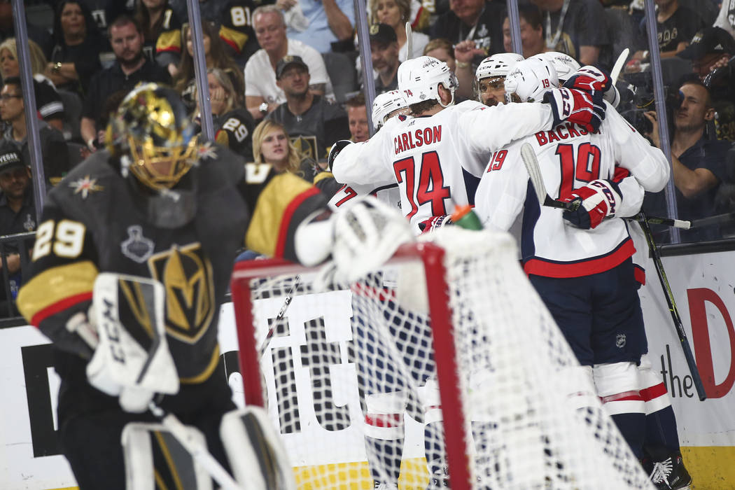 Washington Capitals players celebrate a goal past Golden Knights goaltender Marc-Andre Fleury (29) during the second period of Game 2 of the NHL hockey Stanley Cup Final at the T-Mobile Arena in L ...