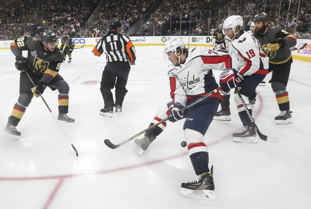 Golden Knights left wing Tomas Nosek (92) chases after the puck controlled by Washington Capitals right wing T.J. Oshie (77) during the second period of Game 2 of the NHL hockey Stanley Cup Final ...