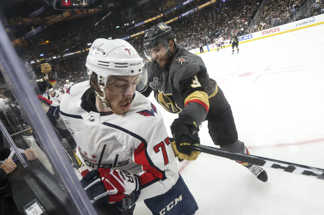 Golden Knights defenseman Brayden McNabb (3) cross checks Washington Capitals right wing T.J. Oshie (77) during the second period of Game 2 of the NHL hockey Stanley Cup Final at the T-Mobile Aren ...