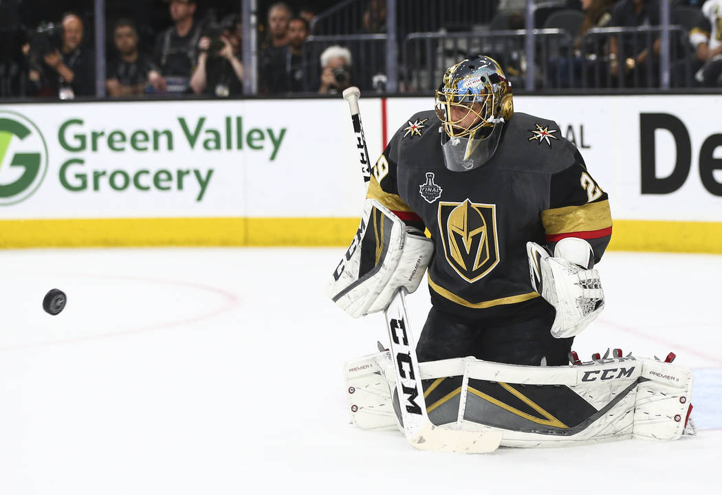 Golden Knights goaltender Marc-Andre Fleury (29) blocks a shot from the Washington Capitals during the second period of Game 2 of the NHL hockey Stanley Cup Final at the T-Mobile Arena in Las Vega ...