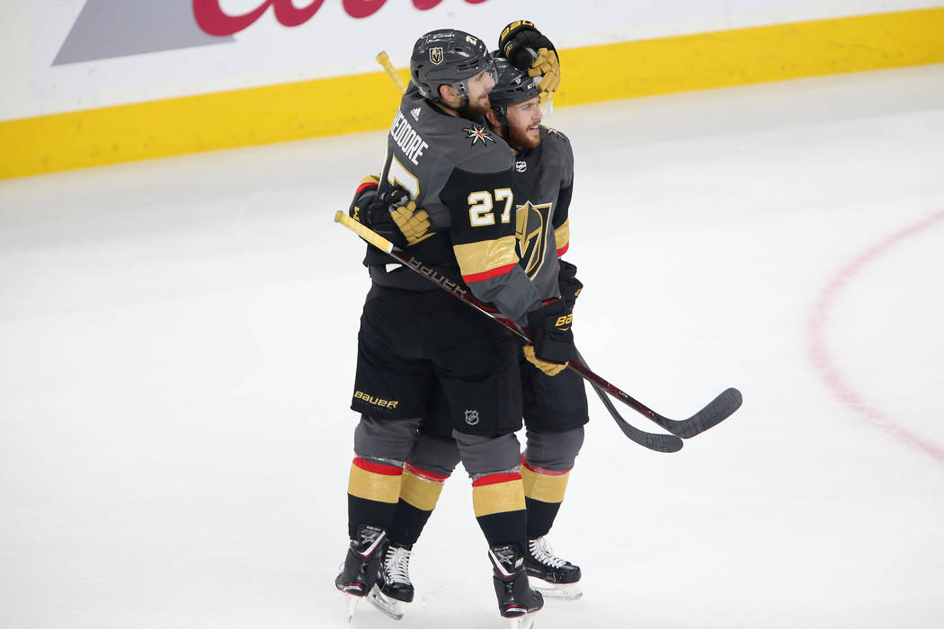 Vegas Golden Knights defenseman Shea Theodore (27) celebrates his score with center Jonathan Marchessault (81) against Washington Capitals during the second period in Game 2 of the NHL hockey Stan ...