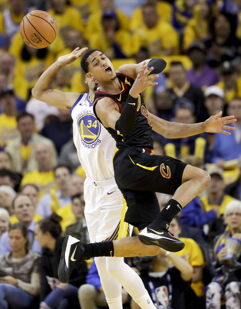 Cleveland Cavaliers guard Jordan Clarkson, foreground, loses the ball in front of Golden State Warriors guard Shaun Livingston during the first half of Game 1 of basketball's NBA Finals in Oakland ...