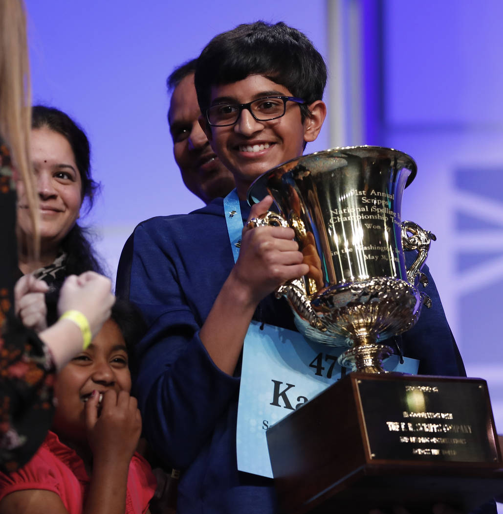 Karthik Nemmani, 14, from McKinney, Texas, holds the Scripps National Spelling Bee Championship Trophy after winning the Scripps National Spelling Bee in Oxon Hill, Md., Thursday, May 31, 2018. (A ...