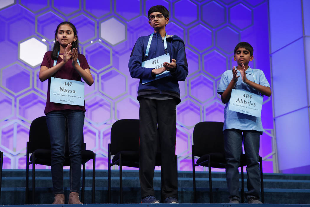 The final three competitors in the Scripps National Spelling Bee, from left, Naysa Modi, 12, from Frisco, Texas, Karthik Nemmani, 14, from McKinney, Texas, and Abhijay Kodali, 11, from Flower Moun ...