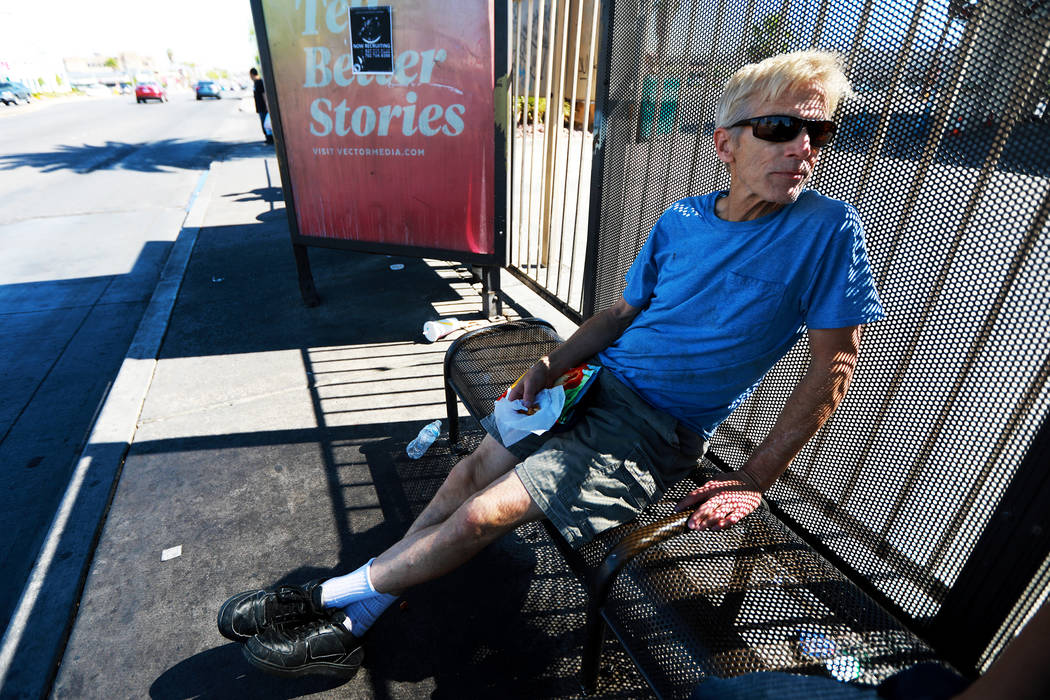 Michael John Perkins, 56, waits for the bus at the bus stop near the intersection of Flamingo Road and Maryland Parkway in Las Vegas on Friday, May 4, 2018. Andrea Cornejo Las Vegas Review-Journal ...