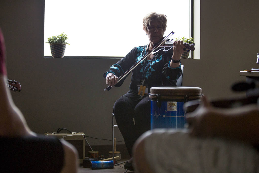 Music therapist Judith Pinkerton plays the violin in a session working with recovering addicts at the Resolutions Recovery center in Las Vegas on Tuesday, April 26, 2018. Patrick Connolly Las Veg ...
