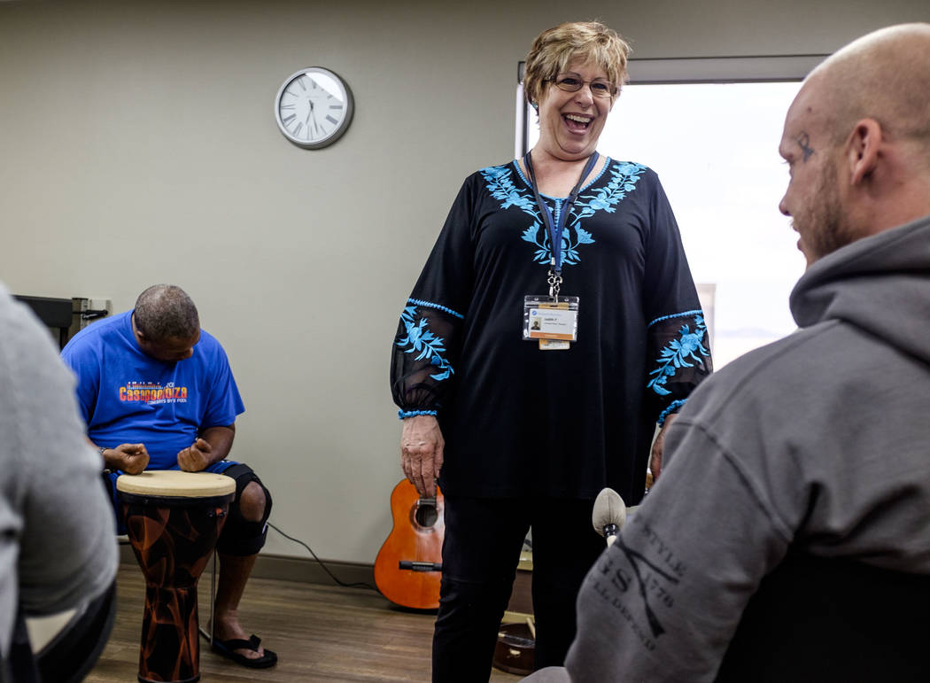 Music therapist Judith Pinkerton shares a moment with Josh Thomas while working in a session with recovering addicts at the Resolutions Recovery center in Las Vegas on Tuesday, April 26, 2018. Pa ...