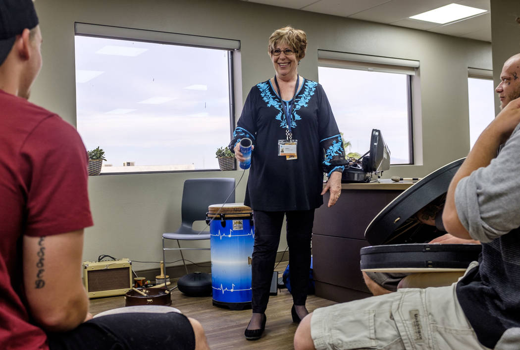 Music therapist Judith Pinkerton shows recovering addicts how to use an instrument to make a thunderstorm sound at the Resolutions Recovery center in Las Vegas on Tuesday, April 26, 2018. Patrick ...
