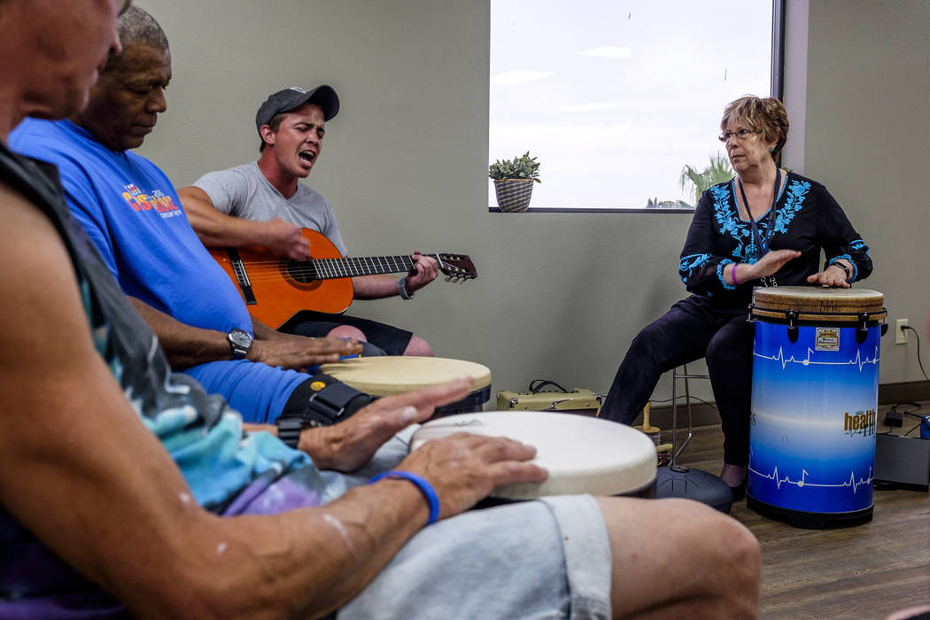 Music therapist Judith Pinkerton works with recovering addicts, including singer and guitarist Shawn Wallen at the Resolutions Recovery center in Las Vegas on Tuesday, April 26, 2018. Patrick Con ...