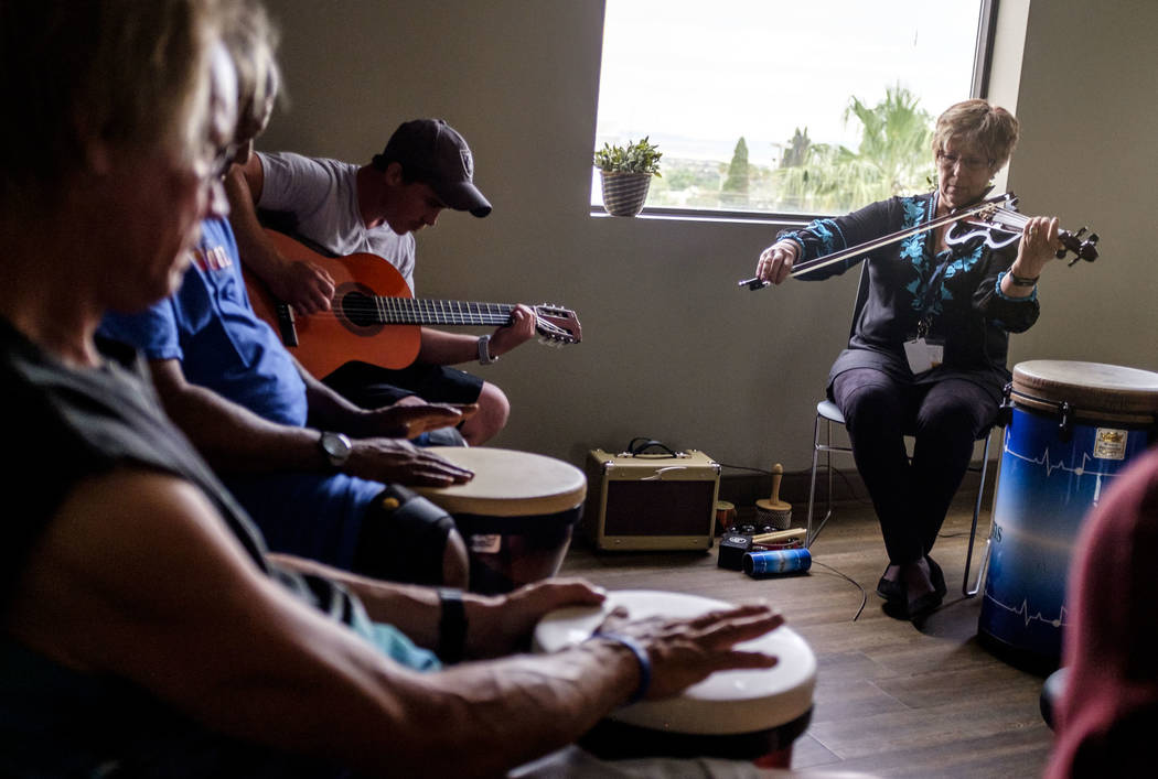 Music therapist Judith Pinkerton plays the violin while Shawn Wallen plays guitar in a session working with recovering addicts at the Resolutions Recovery center in Las Vegas on Tuesday, April 26, ...