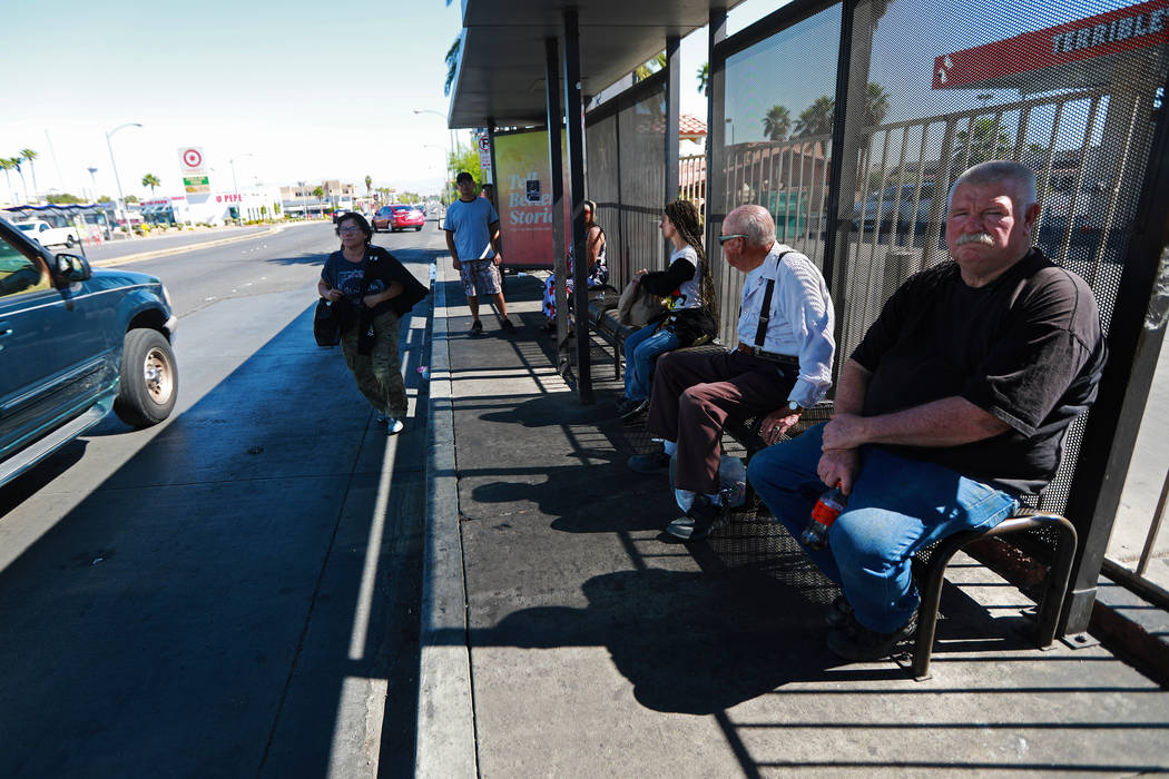 Riders wait for the bus at the stop near the intersection of Flamingo Road and Maryland Parkway in Las Vegas on Friday, May 4, 2018. Andrea Cornejo Las Vegas Review-Journal @dreacornejo