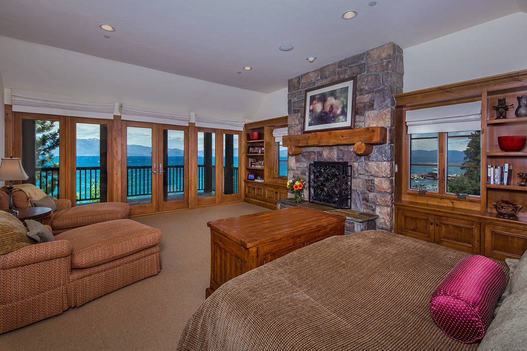 The master bedroom opens to a balcony overlooking the lake. (Oliver Luxury Real Estate)