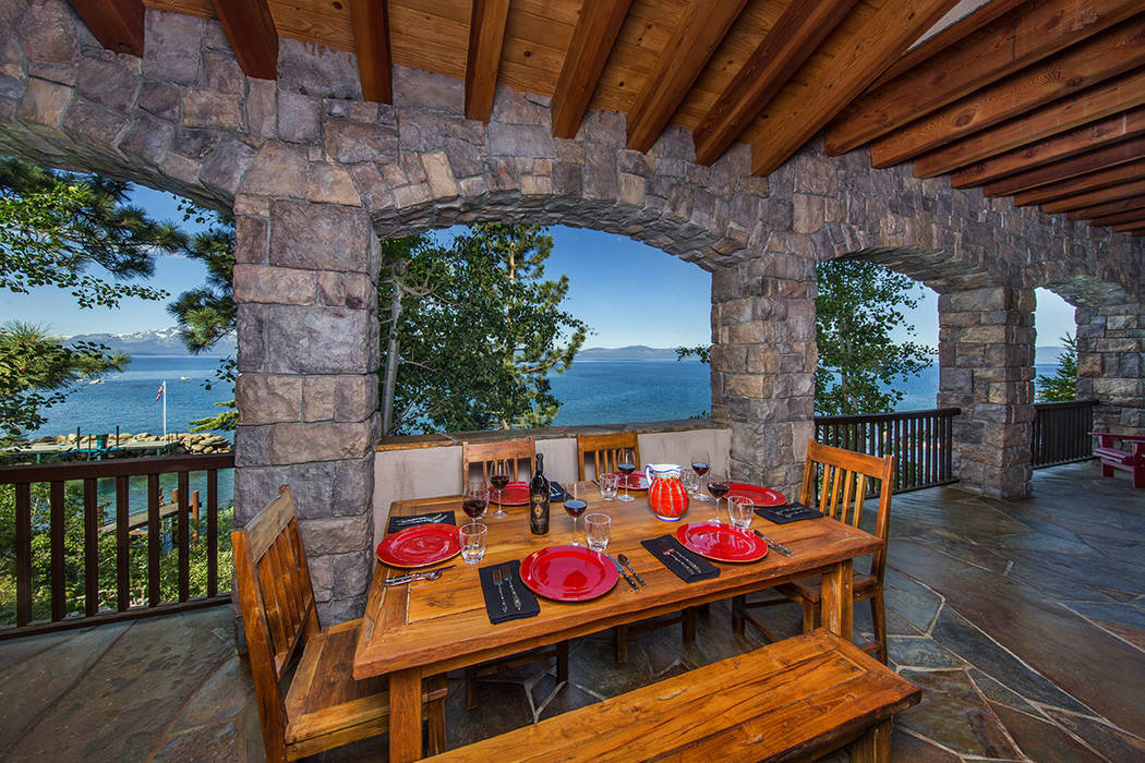 The patio overlooks the lake. (Oliver Luxury Real Estate)