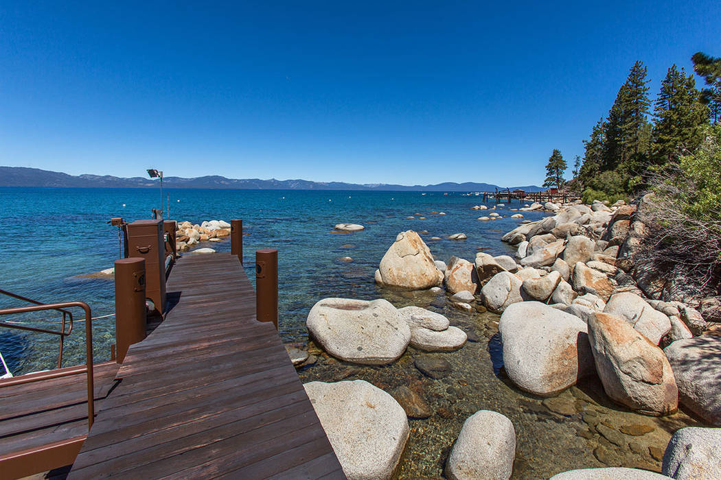 The estate boasts a shared pier with a neighbor and has two private buoys. (Oliver Luxury Real Estate)