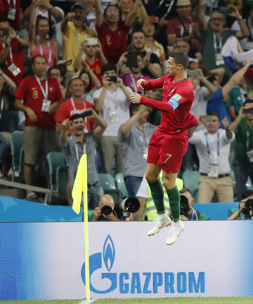 Portugal's Cristiano Ronaldo celebrates after he scored his third goal with a free kick during the group B match between Portugal and Spain at the 2018 soccer World Cup in the Fisht Stadium in Soc ...
