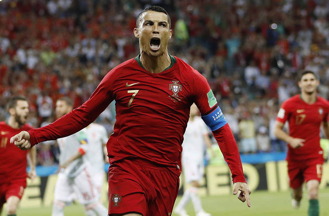Portugal's Cristiano Ronaldo celebrates his side's opening goal during the group B match between Portugal and Spain at the 2018 soccer World Cup in the Fisht Stadium in Sochi, Russia, Friday, June ...