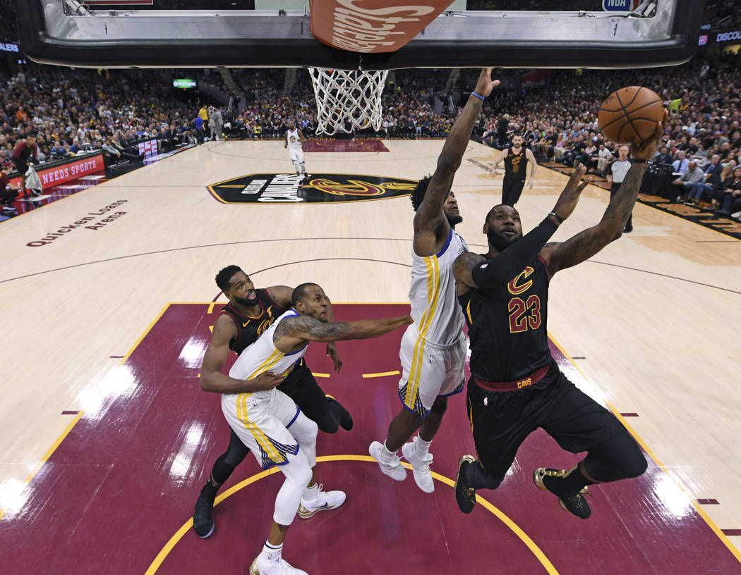 Cleveland Cavaliers' LeBron James shoots during the first half of Game 4 of basketball's NBA Finals against the Golden State Warriors, Friday, June 8, 2018, in Cleveland. (Gregory Shamus/Pool Phot ...