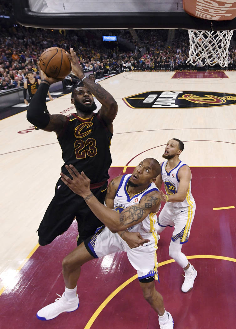 Cleveland Cavaliers' LeBron James shoots over Golden State Warriors' David West during the first half of Game 4 of basketball's NBA Finals, Friday, June 8, 2018, in Cleveland. (Gregory Shamus/Pool ...