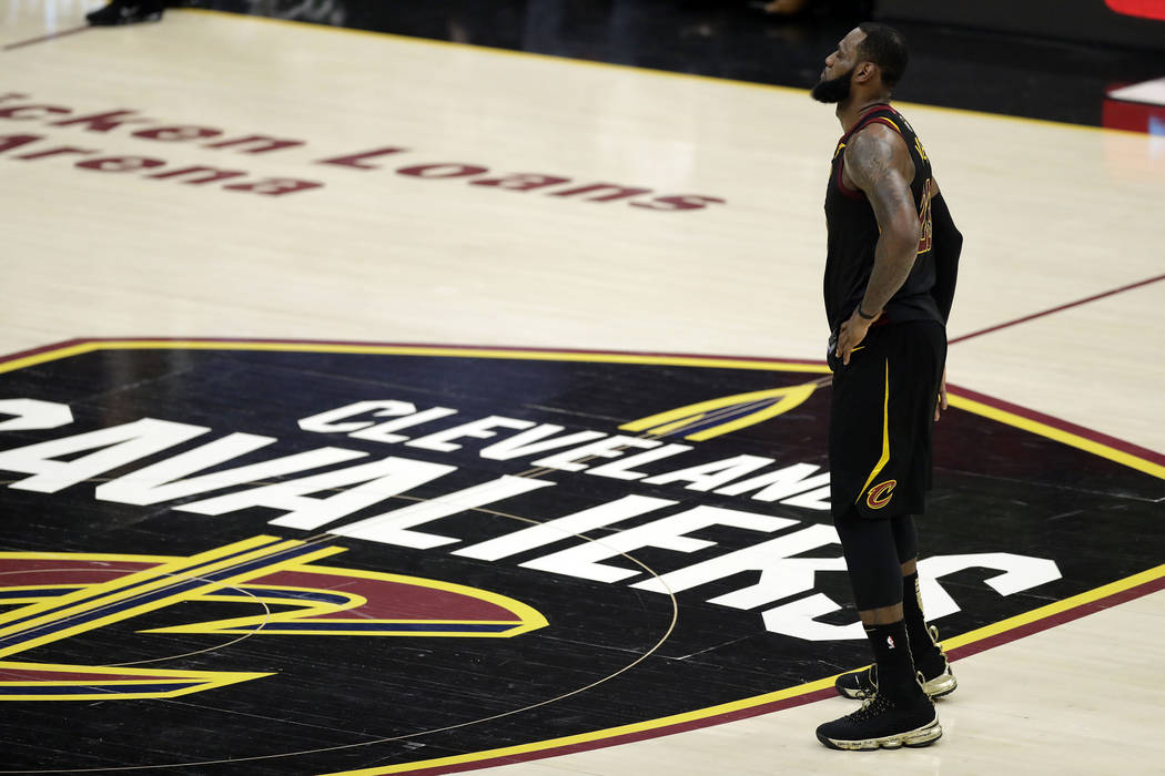 FILE - In this June 8, 2018, file photo, Cleveland Cavaliers' LeBron James watches during the first half of Game 4 of basketball's NBA Finals against the Golden State Warriors, in Cleveland. James ...