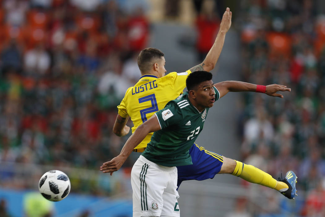 Mexico's Jesus Gallardo, right, and Sweden's Mikael Lustig challenge for the ball during the group F match between Mexico and Sweden, at the 2018 soccer World Cup in the Yekaterinburg Arena in Yek ...