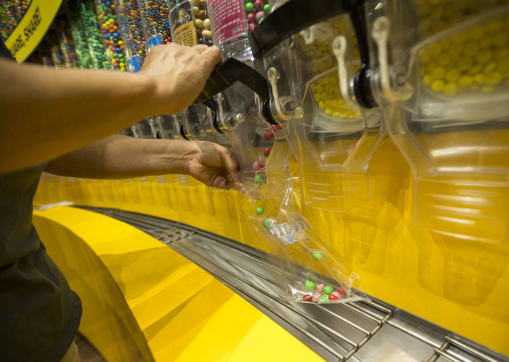 Patrons shop for candy at M&M's World in Las Vegas on Thursday, May 31, 2018. Richard Brian Las Vegas Review-Journal @vegasphotograph