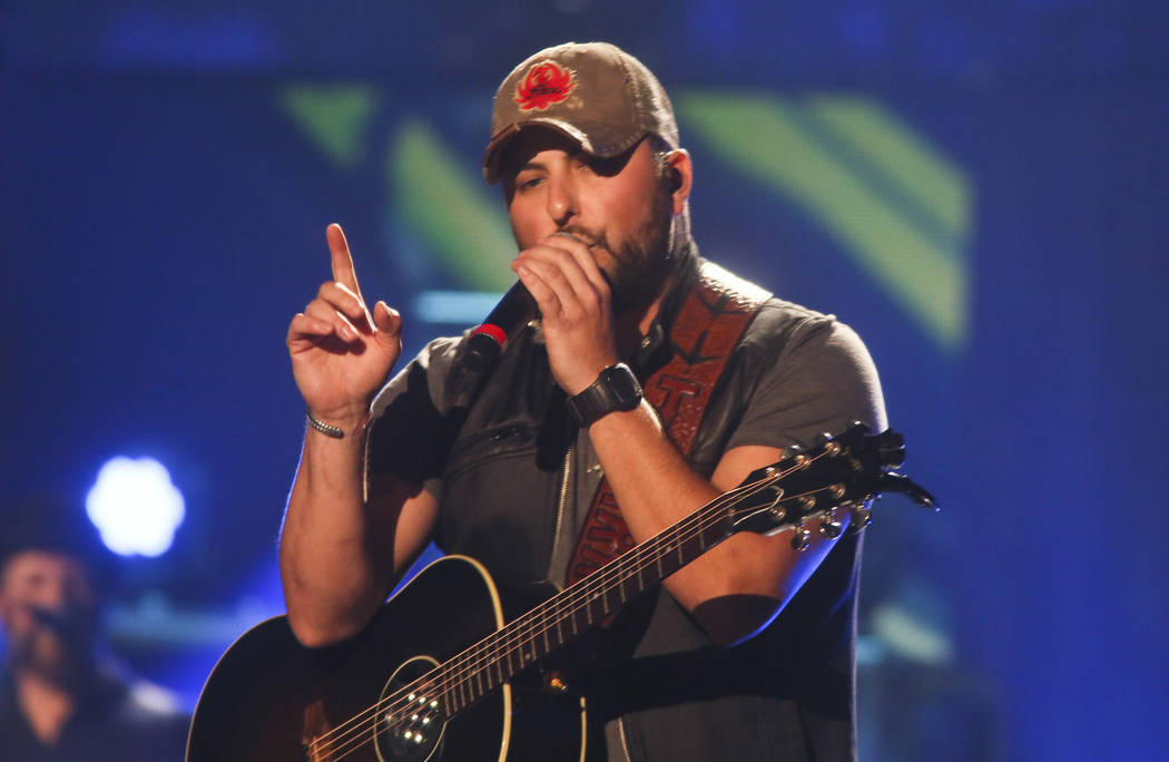 Tyler Farr performs at the iHeartRadio Country Festival held at the Frank Erwin Center on Saturday, May 2, 2015 in Austin, Texas.. (Photo by [Jack Plunkett/Invision/AP)