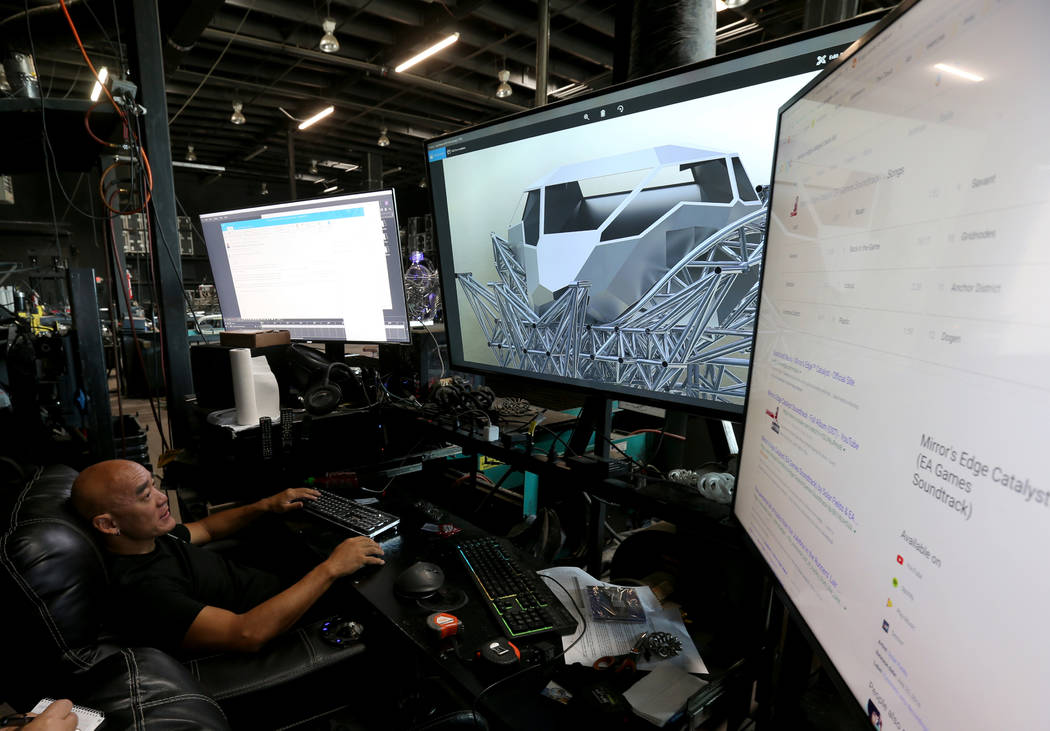 Artist Henry Chang shows designs for art cars at his Las Vegas studio Wednesday, May 30, 2018, in preparation for the upcoming Intergalactic Art Car Festival on Saturday, June 9. The festival will ...