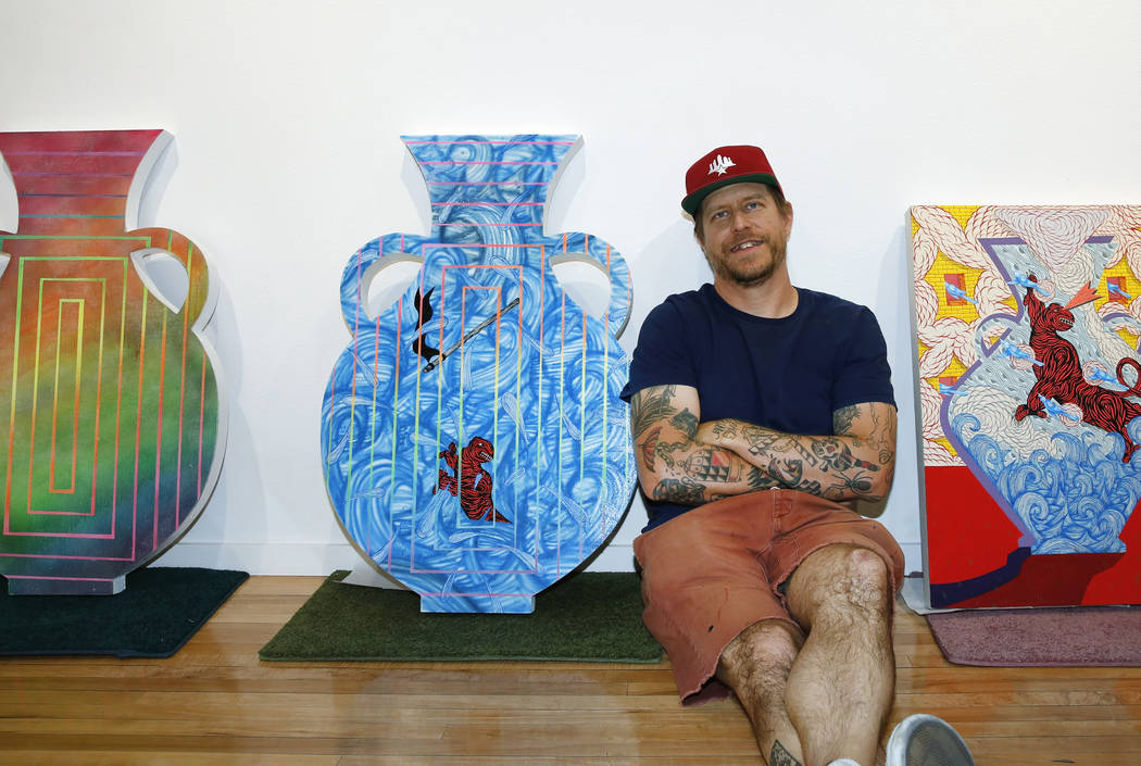 Los Angeles-based artist, Andrew Schoultz, poses for photo with his artwork at the UNLV Marjorie Barrick Museum of Art on Friday, May 25, 2018, in Las Vegas. Schoultz's art exhibit will be held fr ...