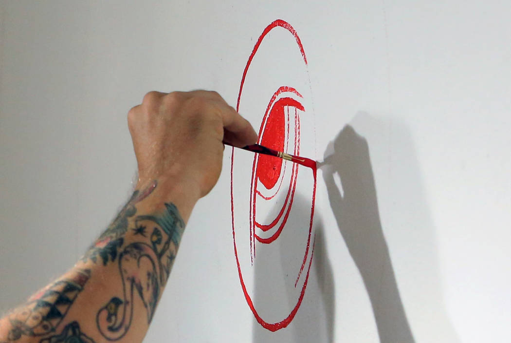 Los Angeles-based artist, Andrew Schoultz, paints on the wall on Friday, May 25, 2018, as he prepares for his upcoming exhibit at the UNLV Marjorie Barrick Museum of Art in Las Vegas. Bizuayehu Te ...