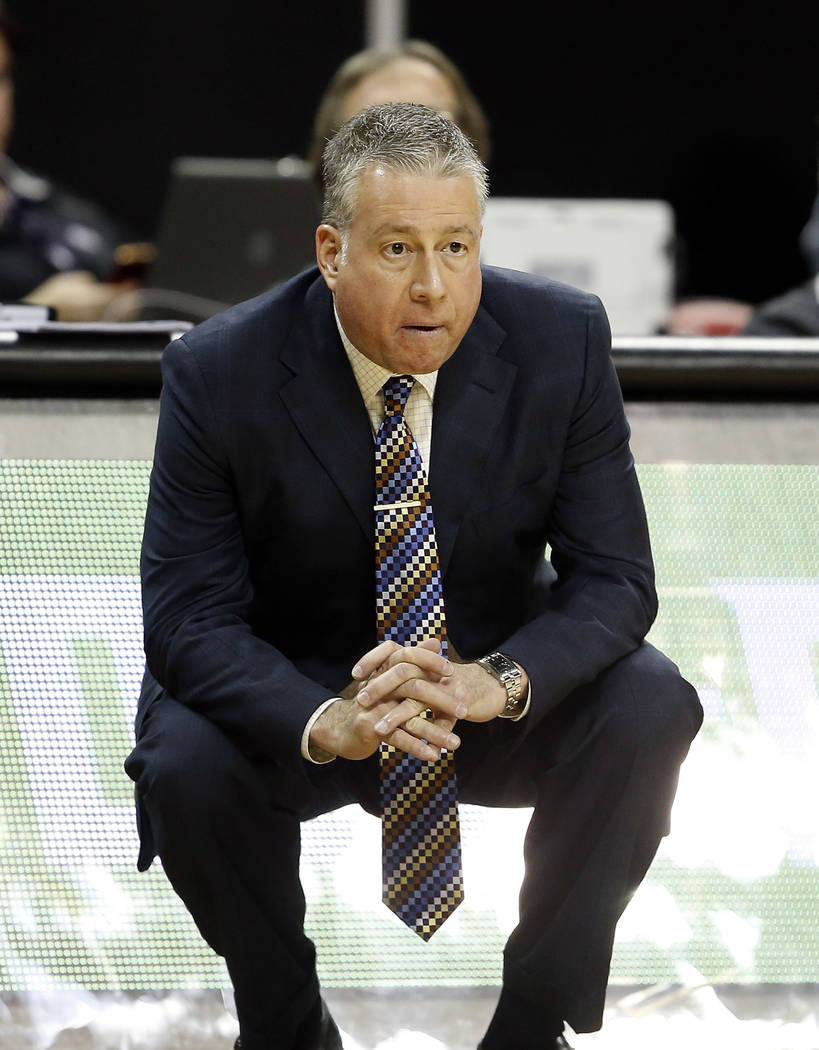 Air Force head coach Dave Pilipovich watches his team during the second half of an NCAA college basketball game against Colorado State in the Mountain West Conference tournament Thursday, March 9, ...