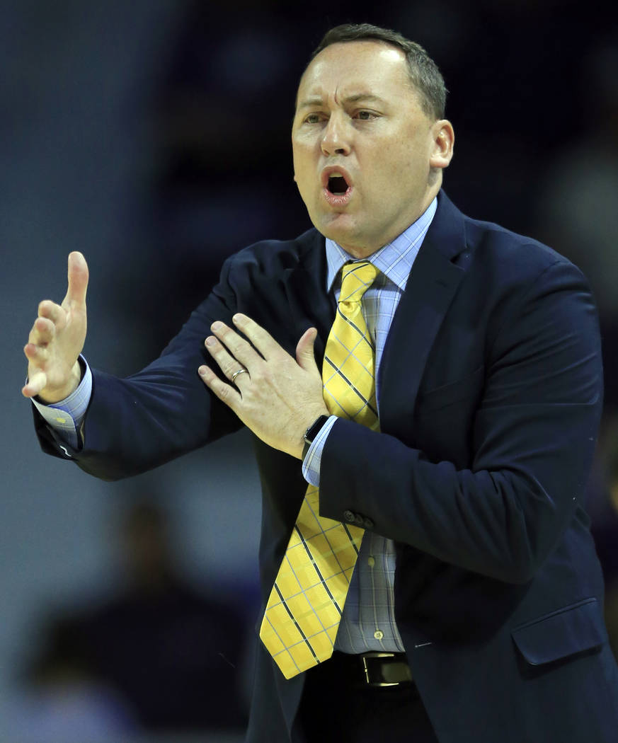 Northern Arizona head coach Jack Murphy directs his team during the first half of an NCAA college basketball game against Kansas State in Manhattan, Kan., Monday, Nov. 20, 2017. (AP Photo/Orlin Wa ...