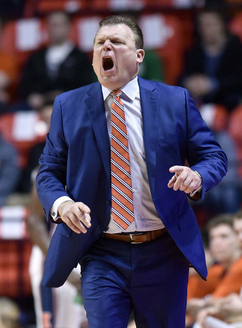 Illinois coach Brad Underwood calls out from the bench during the first half of the team's NCAA college basketball game against Purdue in Champaign, Ill., Thursday, Feb. 22, 2018. (AP Photo/Stephe ...
