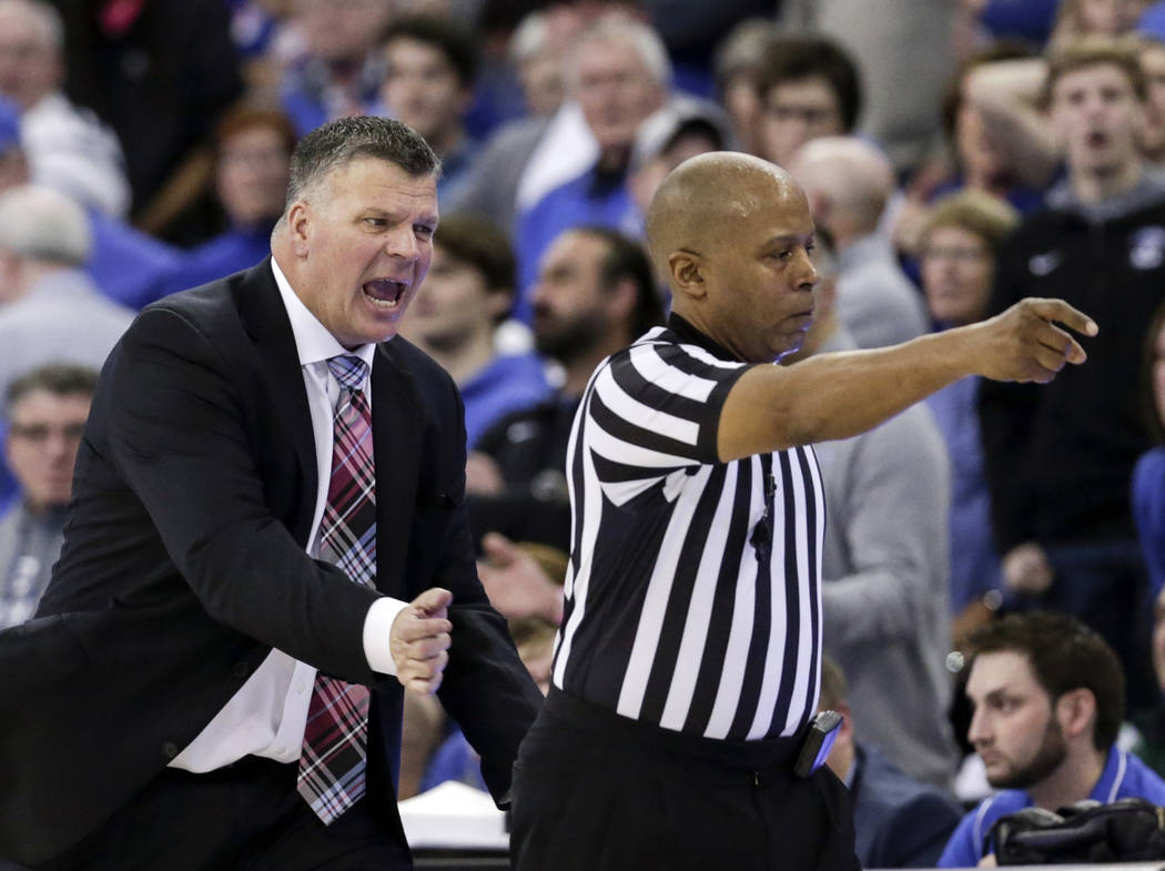 Creighton coach Greg McDermott, left, protests a call against his team to referee Lamar Simpson, during the second half of an NCAA college basketball game in Omaha, Neb., Saturday, Feb. 24, 2018. ...