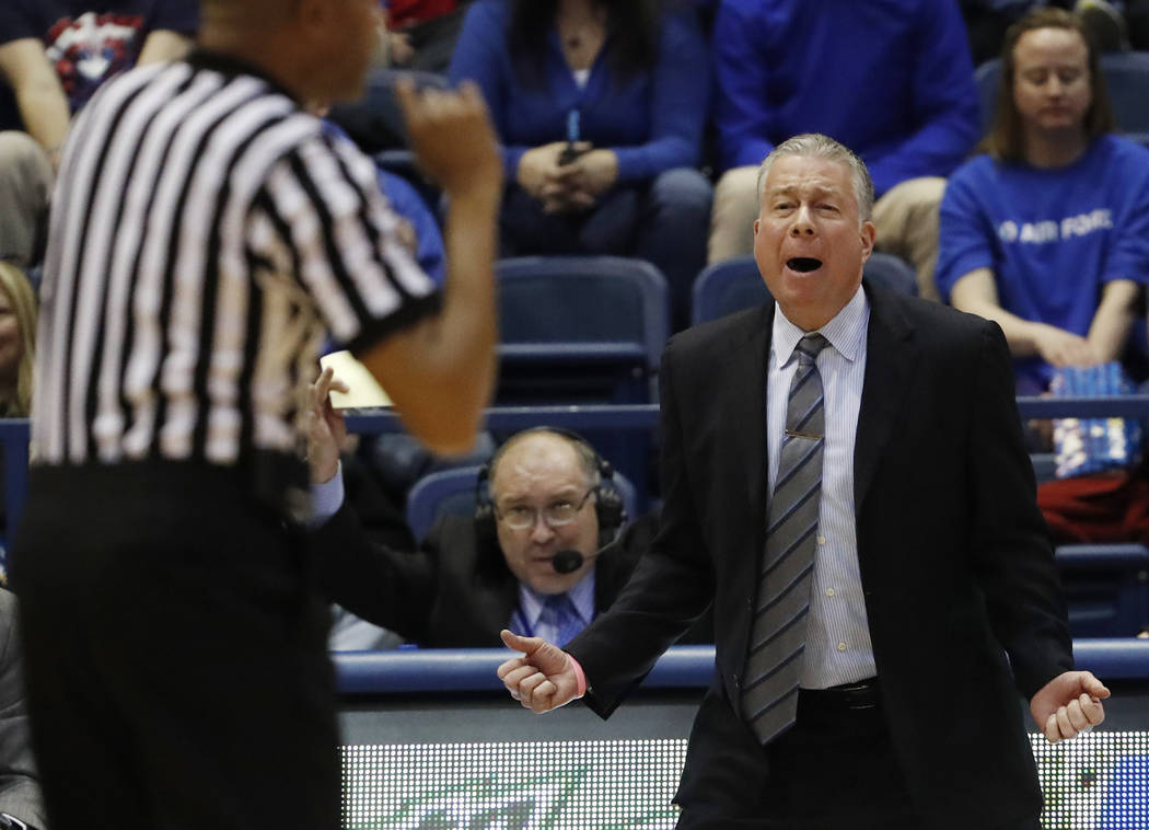 Air Force head coach Dave Pilipovich, right, reacts to a call against his team in the second half of an NCAA college basketball game against Utah State, Saturday, Feb. 24, 2018, at Air Force Acade ...